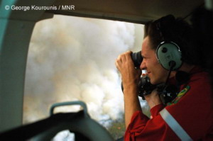 In a helicopter flying over raging forest fires north of Lake Superior, Canada