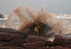Bracing against the powerful force of the Arabian Sea during a storm